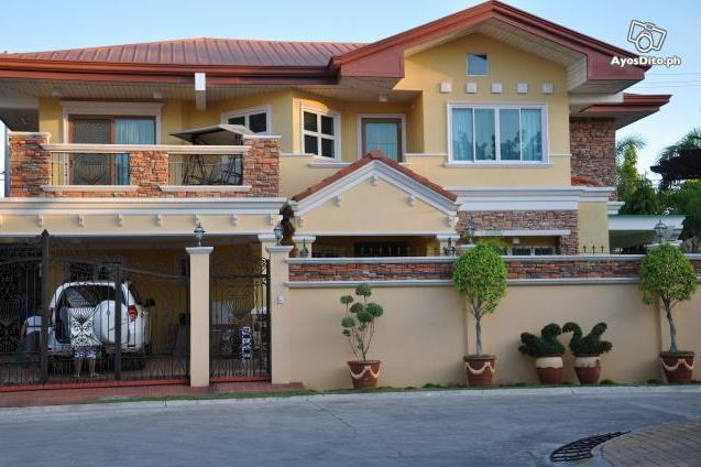 The house above is located at Villa del Rio in Mactan and it costs