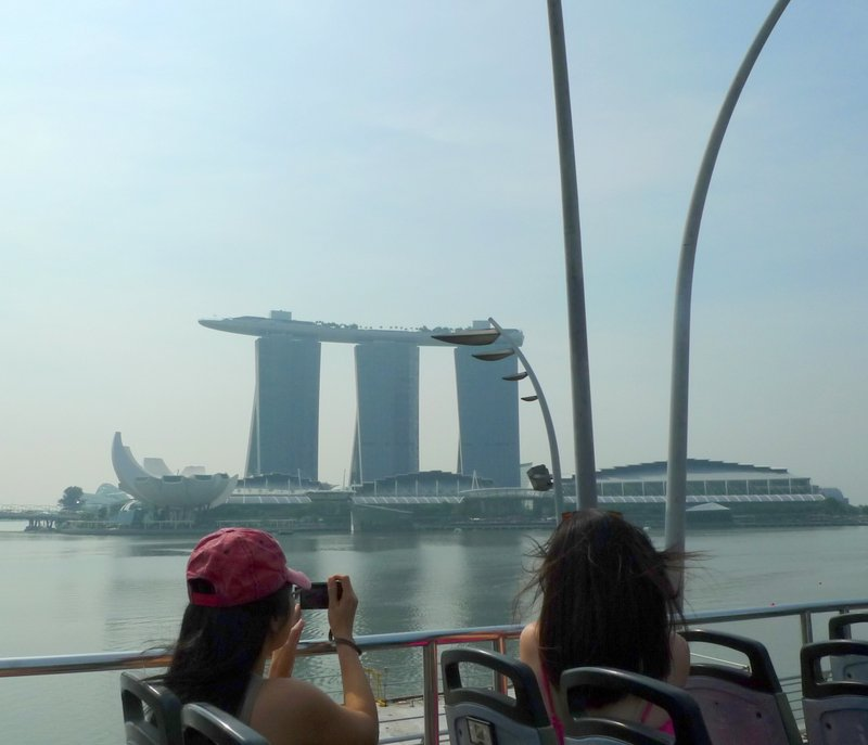 Bloggers taking photos of Marina Bay Sands from the FunVee Top Deck Bus