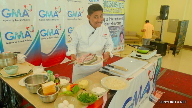 Chef Boy Logro smiles as he prepare for his cooking demonstration