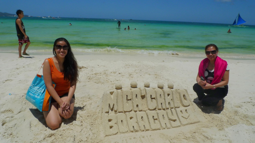 The kids created this sand sculpture with my name and Carlo's name on it :D