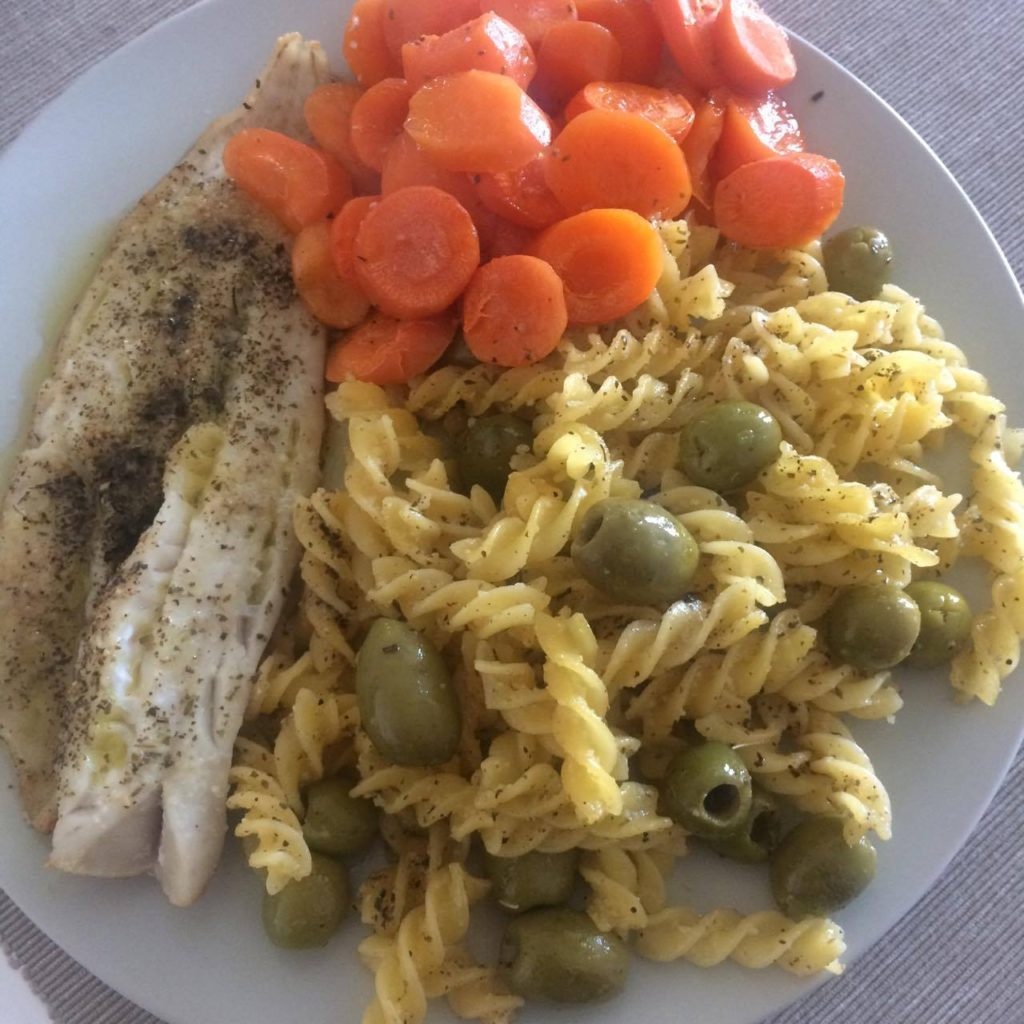 Trying to cook Italian style. Baked fish and carrots. Pasta with olives. But of course you don't all put them in a single plate!